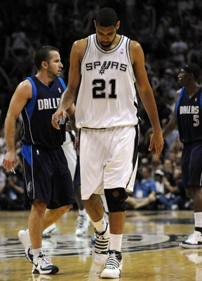SAN ANTONIO - APRIL 28:   Forward Tim Duncan #21 of the San Antonio Spurs reacts during a 106-93 loss against the Dallas Mavericks in Game Five of the Western Conference Quarterfinals during the 2009 NBA Playoffs at AT&T Center on April 28, 2009 in San An