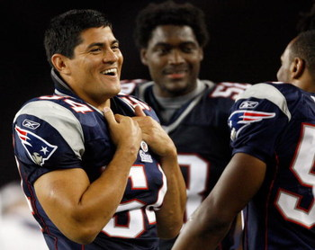 FOXBORO, MA - AUGUST 7: Tedy Bruschi #54 of the New England Patriots laughs from the sideline against the Baltimore Ravens during the preseason game at Gillette Stadium on August 7, 2008 in Foxboro, Massachusetts. (Photo by Jim Rogash/Getty Images)