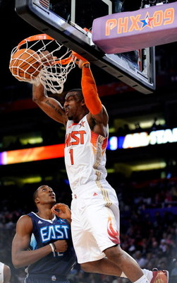 PHOENIX - FEBRUARY 15:  Amar'e Stoudemire #1 of the Western Conference dunks over Dwight Howard #12 of the Eastern Conference during the 58th NBA All-Star Game, part of 2009 NBA All-Star Weekend at US Airways Center on February 15, 2009 in Phoenix, Arizon
