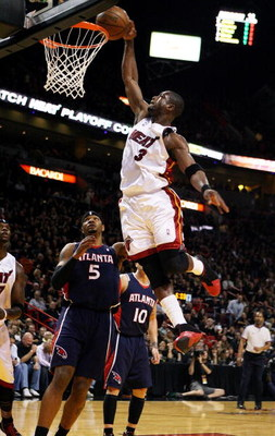MIAMI - APRIL 25:  Dwyane Wade #3 of the Miami Heat dunks over Josh Smith #5 of the Atlanta Hawks during Game Three of the Eastern Conference Quarterfinals at American Airlines Arena on April 25, 2009 in Miami, Florida. NOTE TO USER: User expressly acknow