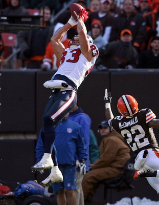 CLEVELAND - NOVEMBER 23:  Kevin Walter #83 of the Houston Texans catches a touchdown pass while defended by Brandon McDonald #22 of the Cleveland Browns during the NFL game at Cleveland Browns Stadium on November 23, 2008 in Cleveland, Ohio.  (Photo by An
