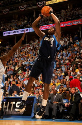 DENVER - MAY 13:  Josh Howard #5 of the Dallas Mavericks takes a shot against the Denver Nuggets in Game Five of the Western Conference Semifinals during the 2009 NBA Playoffs at Pepsi Center on May 13, 2009 in Denver, Colorado.  The Nuggets defeated the