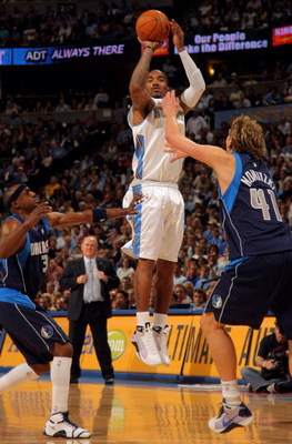 DENVER - MAY 05:  J.R. Smith #1 of the Denver Nuggets shoots over Dirk Nowitzki #41 of the Dallas Mavericks in Game Two of the Western Conference Semifinals during the 2009 NBA Playoffs at Pepsi Center on May 5, 2009 in Denver, Colorado. The Nuggets defea