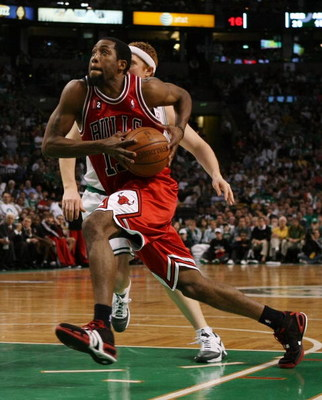 BOSTON - MAY 02:  John Salmons #15 of the Chicago Bulls heads to the net as Brian Scalabrine #44 of the Boston Celtics defends in Game Seven of the Eastern Conference Quarterfinals during the 2009 NBA Playoffs at TD Banknorth Garden on May 2, 2009 in Bost