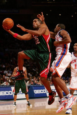NEW YORK - NOVEMBER 30:  Michael Redd #22 of the Milwaukee Bucks drives past Fred Jones #2 of the New York Knicks on November 30, 2007 at Madison Square Garden in New York City. The Knicks won the match 91-88. NOTE TO USER: User expressly acknowledges and