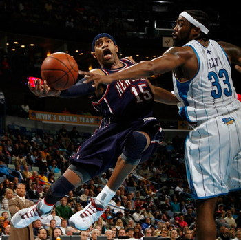 NEW ORLEANS - JANUARY 21:  Vince Carter #15 of the New Jersey Nets shoots around Melvin Ely #33 of the New Orleans Hornets on January 21, 2009 at the New Orleans Arena in New Orleans, Louisiana. The Hornets defeated the Nets 102-92.   NOTE TO USER: User e