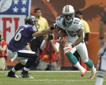 MIAMI, FL - JANUARY 4:  Wide receiver Davone Bess #15 of the Miami Dolphins rushes upfield against the Baltimore Ravens in an NFL Wildcard Playoff Game at Dolphins Stadium on January 4, 2009 in Miami, Florida.  (Photo by Al Messerschmidt/Getty Images)