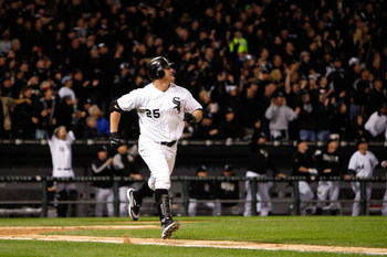 CHICAGO - SEPTEMBER 30:  Jim Thome #25 of the Chicago White Sox runs to first as he watches his solo home run leave the park in the bottom of the seventh inning against the Minnesota Twins during the American League Central Division Tiebreaker game at U.S