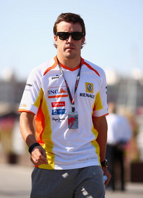 VALENCIA, SPAIN - AUGUST 22:  Fernando Alonso of Spain and Renault walks in the paddock following qualifying for the European Formula One Grand Prix at the Valencia Street Circuit on August 22, 2009, in Valencia, Spain.  (Photo by Ryan Pierse/Getty Images