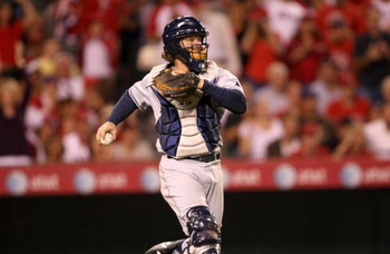 ANAHEIM, CA - AUGUST 11:    Catcher Gregg Zaun  #9 of the Tampa Bay Rays looks to throw against the Los Angeles Angels of Anaheim on August 11, 2009 at Angel Stadium in Anaheim, California.   (Photo by Stephen Dunn/Getty Images)