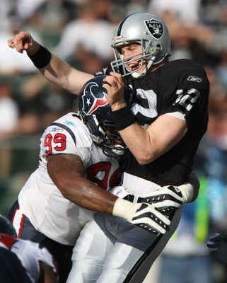 OAKLAND, CA - NOVEMBER 4: Travis Johnson #99 of the Houston hits quarterback Josh McCown #12 of the Oakland Raiders at McAfee Coliseum November 4, 2007 in Oakland, California.  (Photo by Jed Jacobsohn/Getty Images)