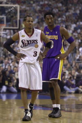 10 Jun 2001:  Allen Iverson #3 of the Philadelphia 76ers stands with Kobe Bryant #8 of the Los Angeles Lakers during game 3 of the NBA Finals at the First Union Center in Philadelphia, Pennsylvania.  DIGITAL IMAGE Mandatory Credit: Ezra Shaw/ALLSPORT. NOT