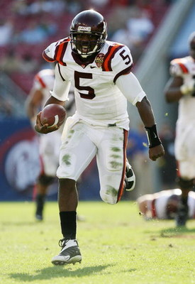 TAMPA, FL - DECEMBER 06:  Quarterback Tyrod Taylor #5 of the Virginia Tech Hokies looks for room to run in the second half while defeating the Boston College Eagles in the 2008 ACC Football Championship game at the Raymond James Stadium on December 6, 200