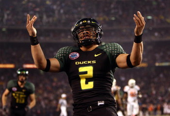 SAN DIEGO, CA - DECEMBER 30:   Quarterback Jeremiah Masoli #2 of the University of Oregon Ducks runs into the endzone for a touchdown against the Oklahoma State University Cowboys during the Pacific Life Holiday Bowl at Qualcomm Stadium on December 30, 20