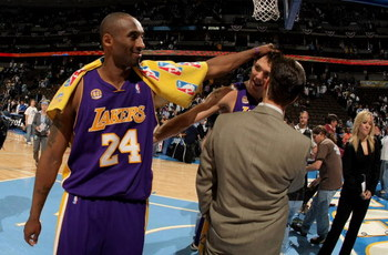 DENVER - APRIL 26:  Kobe Bryant #24 of the Los Angeles Lakers interupts a television interview with teammate Luke Walton #4 after they defeated the Denver Nuggets in Game Three of the Western Conference Quarterfinals during the 2008 NBA Playoffs at the Pe