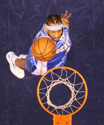 EAST RUTHERFORD, NJ - MARCH 21:  Allen Iverson #3 of the Denver Nuggets scores a layup against the New Jersey Nets during their game on March 21, 2008 at the Izod Arena in East Rutherford, New Jersey.  Photo By Al Bello/Getty Images.  NOTE TO USER: User e