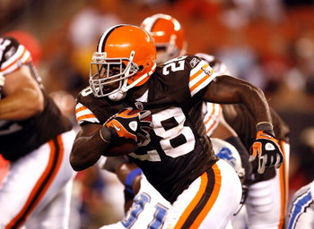 CLEVELAND - AUGUST 22: James Davis #28 of the Cleveland Browns runs throught the Detroit Lions defense for a touchdown during the third quarter of their NFL game in Cleveland Browns Stadium on August 22, 2009 in Cleveland, Ohio.  (Photo by Matt Sullivan/G