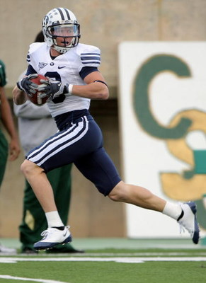 FORT COLLINS, CO - NOVEMBER 01:  Austin Collie #9 of the Brigham Young Cougars makes a pass reception against the Colorado State Rams at Sonny Lubick Field at Hughes Stadium on November 1, 2008 in Fort Collins, Colorado. BYU defeated CSU 45-52.  (Photo by