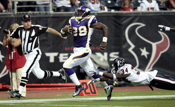 HOUSTON - AUGUST 31:  Running back Adrian Peterson #28 scores on a 75 yard run as strong safety Dominique Barber #34 of the Houston Texans makes a diving attempt to make the tackle at Reliant Stadium on August 31, 2009 in Houston, Texas.  (Photo by Bob Le