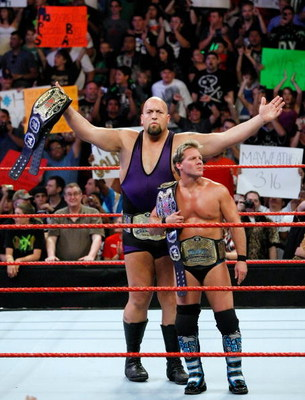 LAS VEGAS - AUGUST 24:  Wrestlers and tag team partners Chris Jericho (L) and Big Show appear in the ring during the WWE Monday Night Raw show at the Thomas & Mack Center August 24, 2009 in Las Vegas, Nevada.  (Photo by Ethan Miller/Getty Images)
