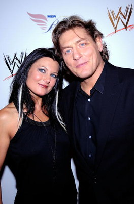 HOLLYWOOD - AUGUST 21:  Wrestlers Katie Lee and  William Regal arrive at the WWE's SummerSlam Kickoff Party at H-Wood Club on August 21, 2009 in Hollywood, California.  (Photo by Frazer Harrison/Getty Images)