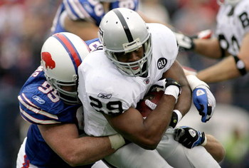 ORCHARD PARK, NY - SEPTEMBER 21: Michael Bush #29 of the Oakland Raiders is tackled by Kyle Williams #95 on September 21, 2008 at Ralph Wilson Stadium in Orchard Park, New York. Buffalo won 24-23. (Photo by Rick Stewart/Getty Images)