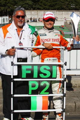 SPA FRANCORCHAMPS, BELGIUM - AUGUST 30:  Second placed Giancarlo Fisichella of Italy and Force India celebrates with his team owner Dr Vijay Mallya and team mates following the Belgian Grand Prix at the Circuit of Spa Francorchamps on August 30, 2009 in S