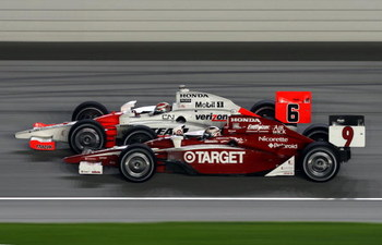 JOLIET, IL- AUGUST 29:  Ryan Briscoe, driver of the #6 Team Penske Honda Dallara, edges out Scott Dixon, driver of the #9 Target Ganassi Honda Dallara, for the fourth closest finish in history during the IRL IndyCar Series PEAK Antifreeze & Motor Oil Indy
