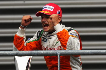 SPA FRANCORCHAMPS, BELGIUM - AUGUST 30:  Second placed Giancarlo Fisichella of Italy and Force India celebrates on the podium following the Belgian Grand Prix at the Circuit of Spa Francorchamps on August 30, 2009 in Spa Francorchamps, Belgium.  (Photo by