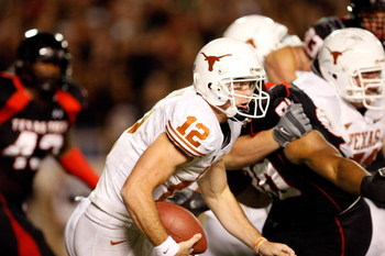 LUBBOCK, TX - NOVEMBER 01:  Quarterback Colt McCoy #12 of the Texas Longhorns scrambles during the first half of the game against the Texas Tech Red Raiders on November 1, 2008 at Jones Stadium in Lubbock, Texas.  (Photo by Jamie Squire/Getty Images)