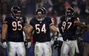 CHICAGO - JANUARY 21:  (L-R) Ian Scott, Brian Urlacher #54 and Mark Anderson #97 of of the Chicago Bears are seen on the field against the New Orleans Saints during the NFC Championship Game January 21, 2007 at Soldier Field in Chicago, Illinois.  (Photo