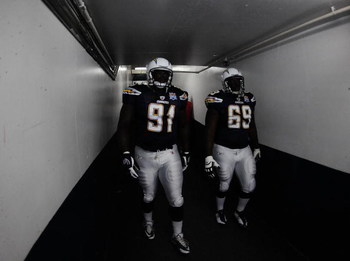 SAN DIEGO - AUGUST 15:  Ogemdi Nwagbuo #91 and Tyronne Green #69 of the San Deigo Chargers walk onto the feild to play the Seattle Seahawks on August 15, 2009 in San Diego, California.  (Photo by Jacob de Golish/Getty Images)