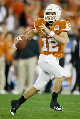 GLENDALE, AZ - JANUARY 05:  Quarterback Colt McCoy #12 of the Texas Longhorns scrambles with the ball against the Ohio State Buckeyes during the Tostitos Fiesta Bowl Game on January 5, 2009 at University of Phoenix Stadium in Glendale, Arizona.  (Photo by