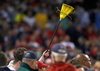 BOSTON - APRIL 26: A fan hold a broom to indicate a three-game Boston Red Sox sweep over the New York Yankees at Fenway Park April 26, 2009 in Boston, Massachusetts. The Red Sox won the game 4-1. (Photo by Jim Rogash/Getty Images)