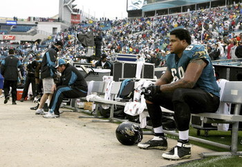 JACKSONVILLE, FL - DECEMBER 24:  Offensive lineman Khalif Barnes #69 of the Jacksonville Jaguars sits on the end of the bench after losing to the New England Patriots on December 24, 2006 at Alltel Stadium in Jacksonville, Florida. The Patriots defeated t