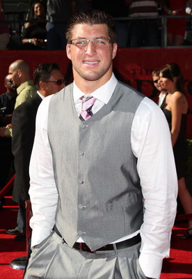 LOS ANGELES, CA - JULY 15:  Football player Tim Tebow arrives at the 2009 ESPY Awards held at Nokia Theatre LA Live on July 15, 2009 in Los Angeles, California. The 17th annual ESPYs will air on Sunday, July 19 at 9PM ET on ESPN.  (Photo by Jason Merritt/