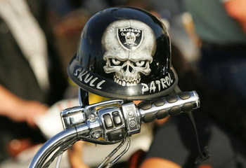OAKLAND, CA - SEPTEMBER 14:  A mini biker helmet with a Oakland Raiders logo is seen on the handle bar of a motorcycle in the parking lot outside Oakland-Alameda County Coliseum prior to the Raiders playing against the San Diego Chargers against the Oakla