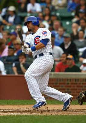 CHICAGO - AUGUST 28: Geovany Soto #18 of the Chicago Cubs hits the ball against the New York Mets on August 28, 2009 at Wrigley Field in Chicago, Illinois. The Cubs defeated the Mets 5-2. (Photo by Jonathan Daniel/Getty Images)