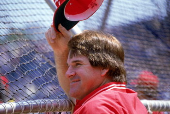 CHICAGO - 1987:  Manager Pete Rose #14 of the Cincinnati Reds tips his cap while watching batting practice before the MLB game against the Chicago Cubs at Wrigley Field during the 1987 season in Chicago, Illinois.  (Photo by Jonathan Daniel/Getty Images)