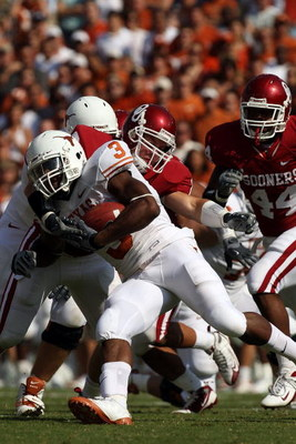DALLAS - OCTOBER 11:  Running back Chris Ogbonnaya #3 of the Texas Longhorns runs against the Oklahoma Sooners at the Cotton Bowl on October 11, 2008 in Dallas, Texas.  (Photo by Ronald Martinez/Getty Images)