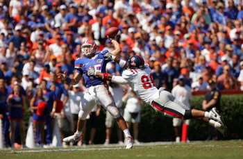 GAINESVILLE, FL - SEPTEMBER 27:  Quarterback Tim Tebow #15 of the Florida Gators is pressured by Greg Hardy #86 of the Ole Miss Rebels during the game at Ben Hill Griffin Stadium on September 27, 2008 in Gainesville, Florida.  (Photo by Sam Greenwood/Gett