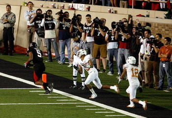 LUBBOCK, TX - NOVEMBER 01:  Michael Crabtree #5 of the Texas Tech Red Raiders carries the ball into the end zone to score the winning touchdown during the game against the Texas Longhorns on November 1, 2008 at Jones Stadium in Lubbock, Texas.  (Photo by