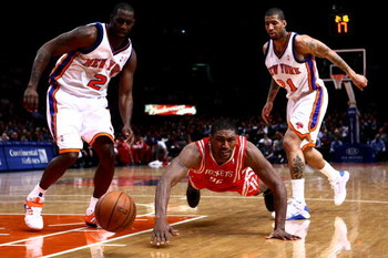 NEW YORK - JANUARY 26: Ron Artest #96 of the Houston Rockets dives for the ball in front of Tim Thomas #2 and Wilson Chandler #21 of the New York Knicks at Madison Square Garden January 26, 2009 in New York City. NOTE TO USER: User expressly acknowledges