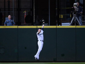 SEATTLE - AUGUST 25:  Left fielder Michael Saunders #55 of the Seattle Mariners makes a leaping catch in the second inning against the Oakland Athletics on August 25, 2009 at Safeco Field in Seattle, Washington. (Photo by Otto Greule Jr/Getty Images)
