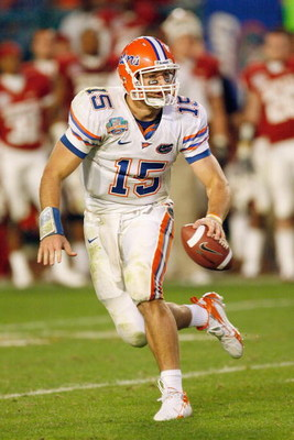 MIAMI - JANUARY 08:  Quarterback Tim Tebow #15 of the Florida Gators runs to pass the ball against the Oklahoma Sooners during the FedEx BCS National Championship Game at Dolphin Stadium on January 8, 2009 in Miami, Florida.  (Photo by Eliot J. Schechter/