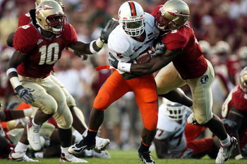 TALLAHASSEE, FL - OCTOBER 20:  Running back Javarris James of the University of Miami Hurricanes runs the ball against the Florida State Seminoles with teammates at Bobby Bowden Field at Doak Campbell Stadium October 20, 2007 in Tallahassee, Florida. Miam