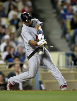 LOS ANGELES - AUGUST 18:  Albert Pujols #5 of the St. Louis Cardinals shatters his bat as he grounds out in the fourth inning against the Los Angeles Dodgers at Dodger Stadium August 18, 2009 in Los Angeles, California.   (Photo by Stephen Dunn/Getty Imag