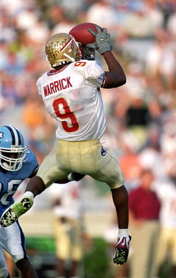 25 Sep 1999: Peter Warrick #9 of the Florida State Seminoles jumps to catch the ball during the game against the North Carolina Tar Heels at the Kenan Stadium in Chapel Hill, North Carolina. The Seminoles defeated the Tar Heels 42-10.