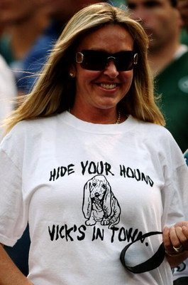 EAST RUTHERFORD, NJ - SEPTEMBER 3:  A wears a shirt which says 'Hide Your Hound Vick's in Town' in protest of quarterback Michael Vick of the Philadelphia Eagles (not in photo) treatment of dogs during the NFL preseason game between the Philadelphia Eagle