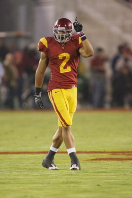 LOS ANGELES - NOVEMBER 29:  Taylor Mays #2 of the USC Trojans gestures as he lines up against the Notre Dame Fighting Irish on November 29, 2008 at the Los Angeles Memorial Coliseum in Los Angeles, California.  USC won 38-3.  (Photo by Jeff Golden/Getty I